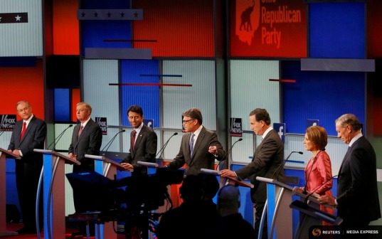 Republican presidential candidates (L-R), former Virginia Governor Jim Gilmore, U.S. Senator Lindsey Graham, Louisiana Governor Bobby Jindal, former Texas Governor Rick Perry, former U.S. Senator Rick Santorum, former HP CEO Carly Fiorina and former New York Governor George Pataki, debate at a Fox-sponsored forum for lower polling candidates held before the first official Republican presidential candidates debate of the 2016 U.S. presidential campaign in Cleveland, Ohio, August 6, 2015. REUTERS/Brian Snyder