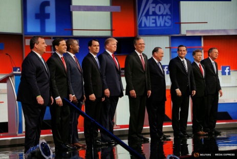 Chris Christie, Marco Rubio, Ben Carson, Scott Walker, Donald Trump, Jeb Bush, Mike Huckabee, Ted Cruz, Rand Paul and John Kasich pose at the start of the debate in Cleveland, Ohio, August 6, 2015.   REUTERS/Brian Snyder