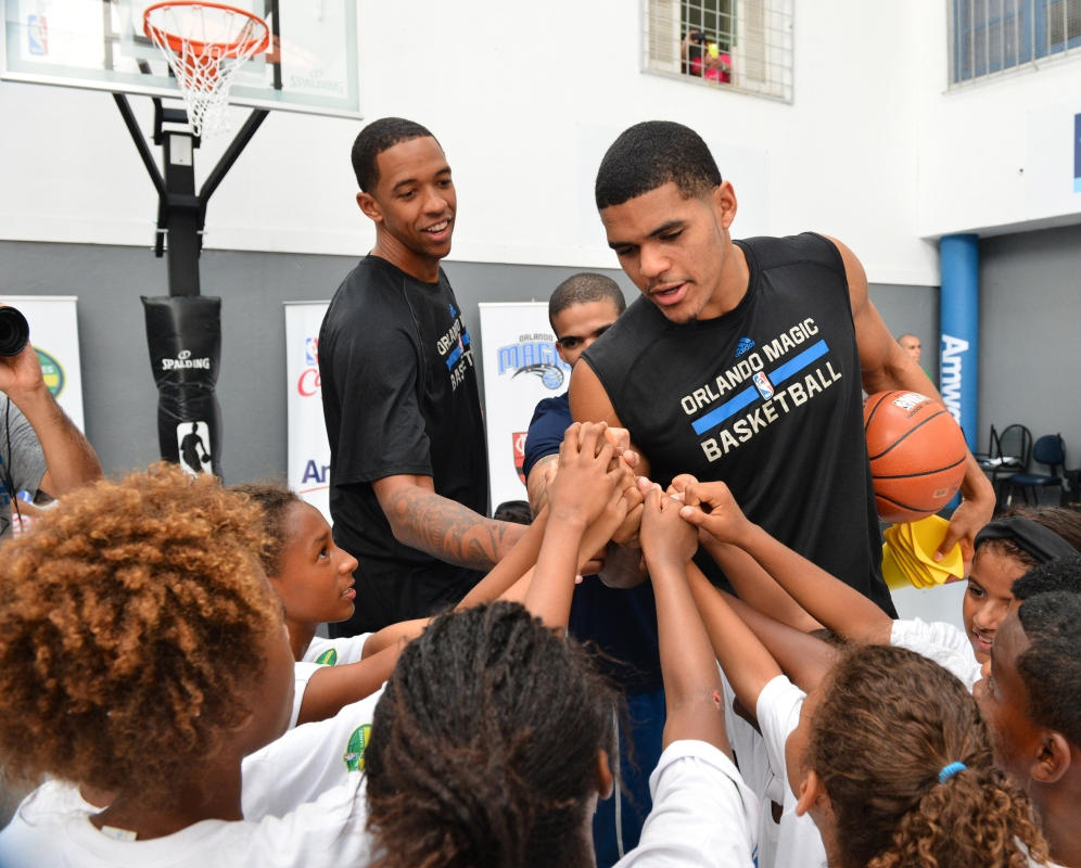 RIO DE JANIERO, BR - OCTOBER 15: Tobias Harris and Channing Frye of the Orlando Magic huddle up during a NBA Cares Court Refurbishment sponsored by AMWAY during the 2015 Global Games on October 15, 2015 at Escola Municipal Santos Anjos in Rio de Janiero, Brazil. NOTE TO USER: User expressly acknowledges and agrees that, by downloading and or using this photograph, User is consenting to the terms and conditions of the Getty Images License Agreement. Mandatory Copyright Notice: Copyright 2015 NBAE (Photo by David Dow/NBAE via Getty Images)