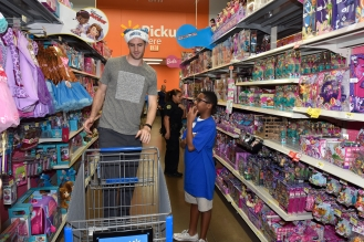 ORLANDO, FL - DECEMBER 17: Orlando Magic players Evan Fournier, Jason Smith and Channing Frye take 100 preselected youth from the Boys and Girls Clubs of Central Florida on a holiday shopping spree on December 17, 2015 at the Walmart at 5991 New Goldenrod Rd., Orlando, Florida. Mandatory Copyright Notice: ©2015 Fernando Medina/Orlando Magic
